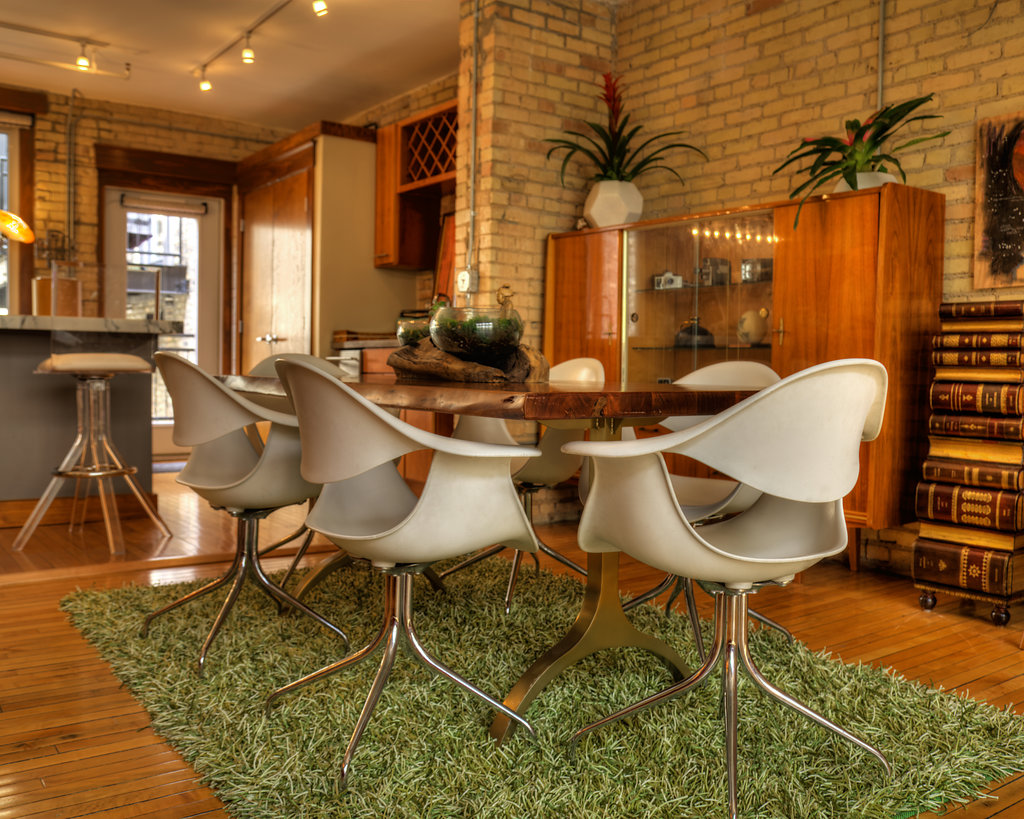 These 2000s  Herman Miller white chairs  could be used in a dining room or office space. Matching them with a rich, wood dining room table creates a beautiful contrast of materials and years.