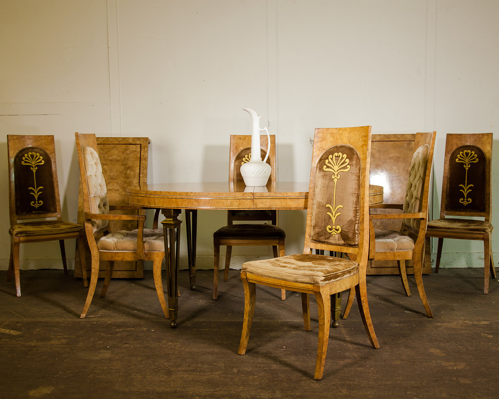 This dining set includes a table that expands with a leaf and padded chairs (two end chairs with arms and four side chairs without arms). Visit Archive Antiques to pick up this gem in time for holiday company. Listed at $1,400 Retail.