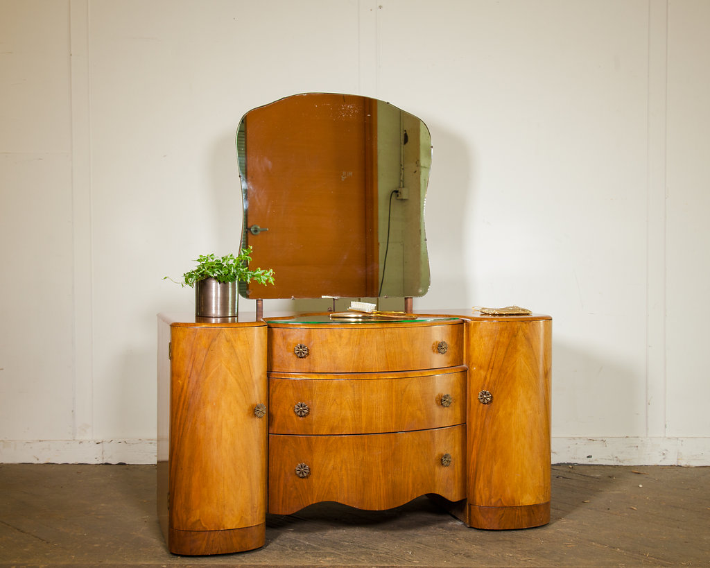 This beautiful, solid wood vanity with mirror and glass top would be a special treat for that special person. Three large drawers and two towers make storage grand. Listed at $800 Retail.