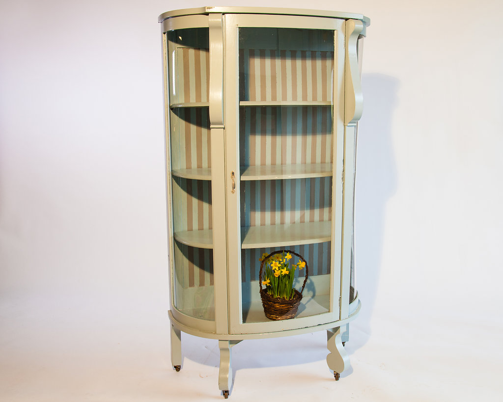 This Wood and Glass Display Cabinet is light blue accented with tan stripes and four shelves. Listed at $350 Retail.