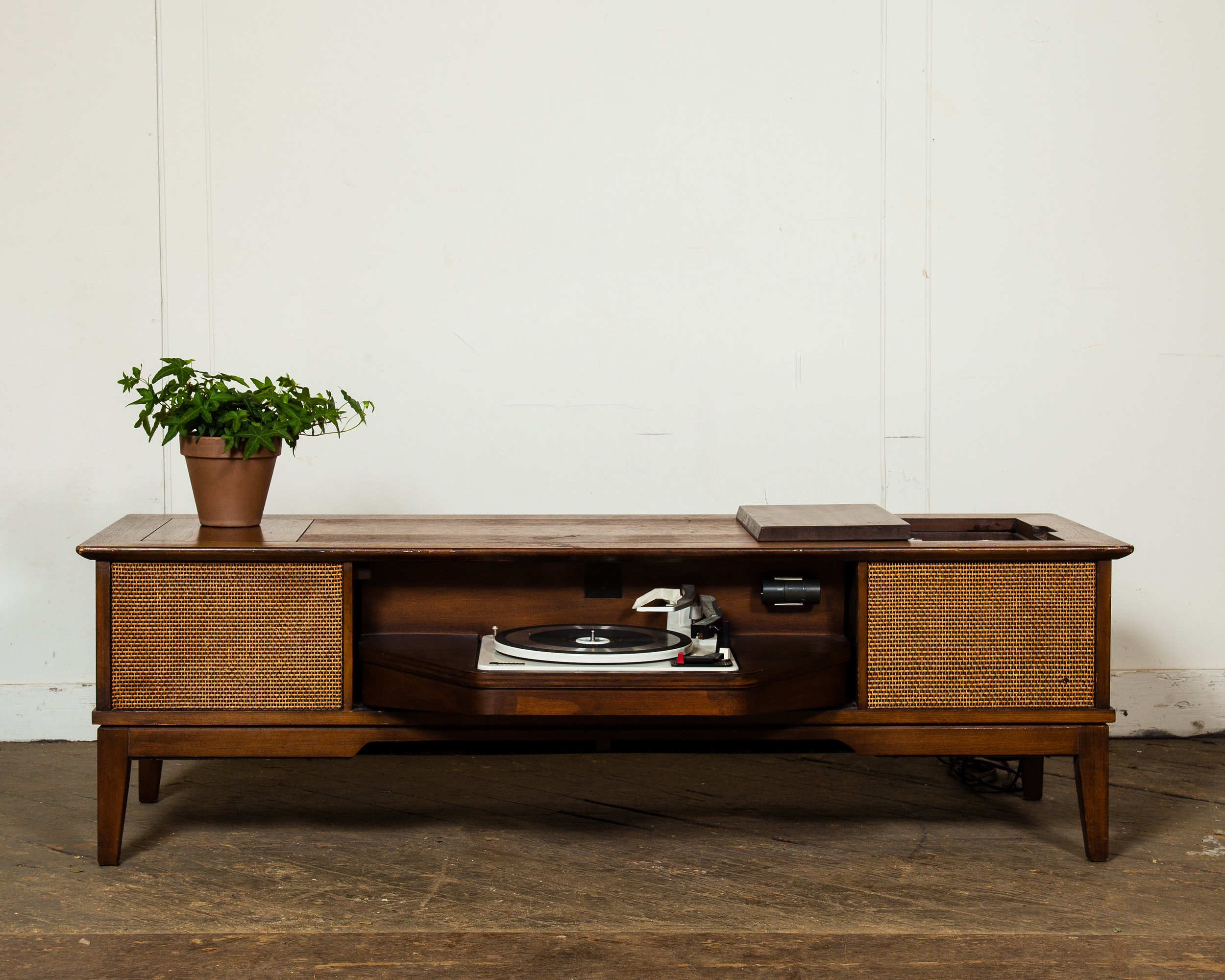 Magnavox Stereo Coffee Table  – There's nothing like being able to pull out old vinyl on a working record player. Gather 'round and spin those favorite vintage holiday 45s and 33s.