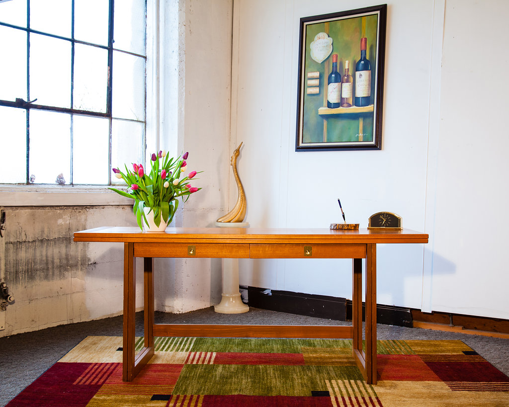 This beautiful desk/table is a Retro Knox staff favorite. It would be a wonderful addition to any office where visitors share the space. Expect ooh's and ah's!