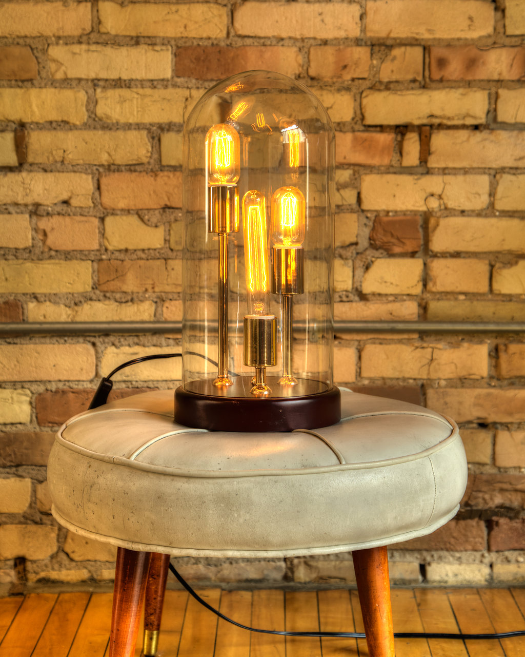 A simple accent of brass adds new texture to a living room. Try this vintage look by including a lamp with brass.