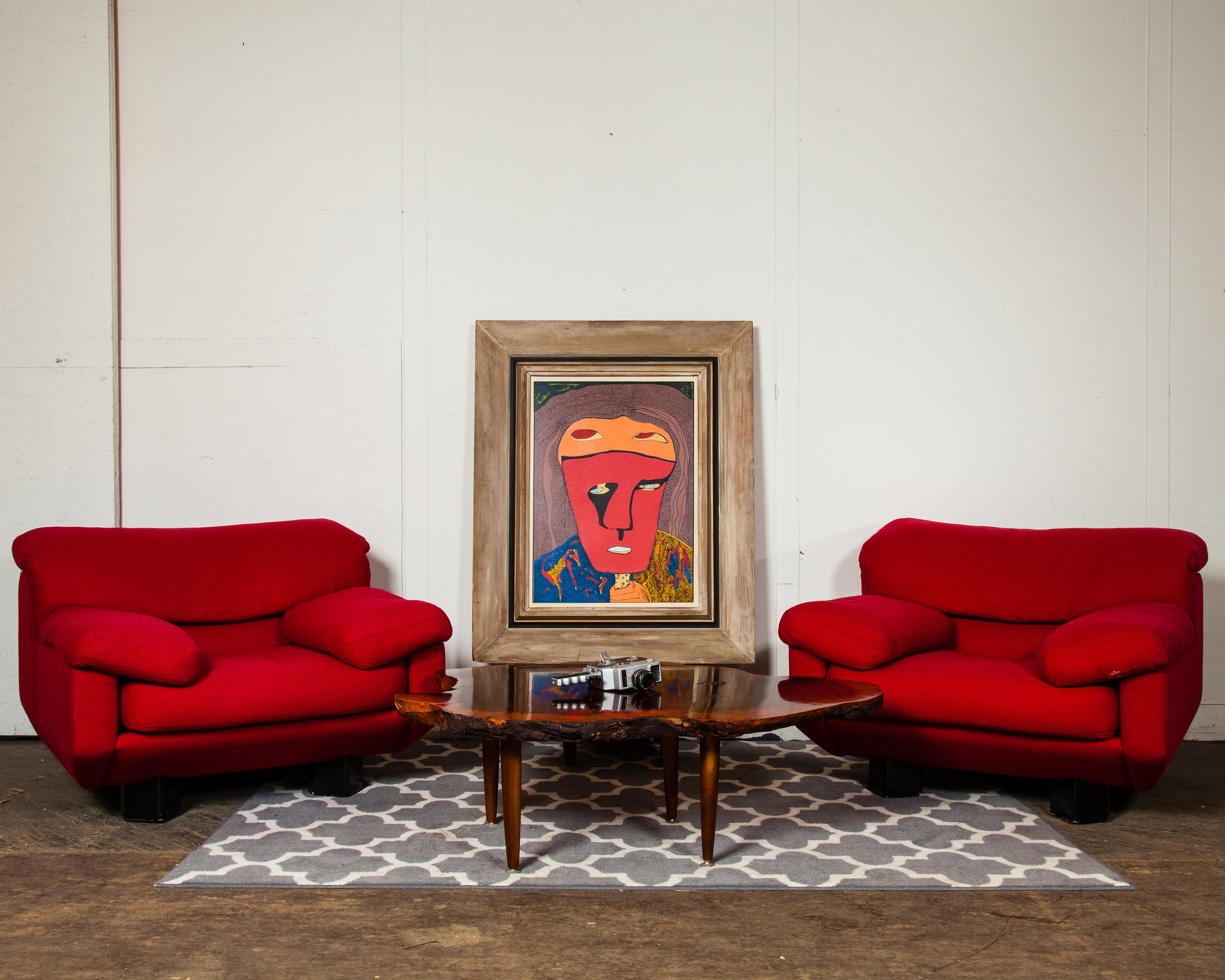 Nothing says love like  red chairs  in a cozy setting for great conversation.