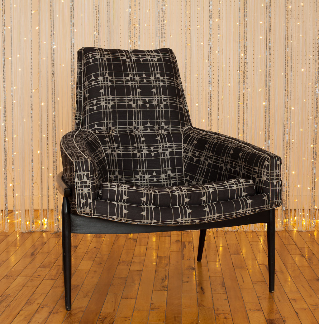 Black and White Danish Modern Chair is the center of attraction for a classic set. Wait 'til you see this fun one in person!