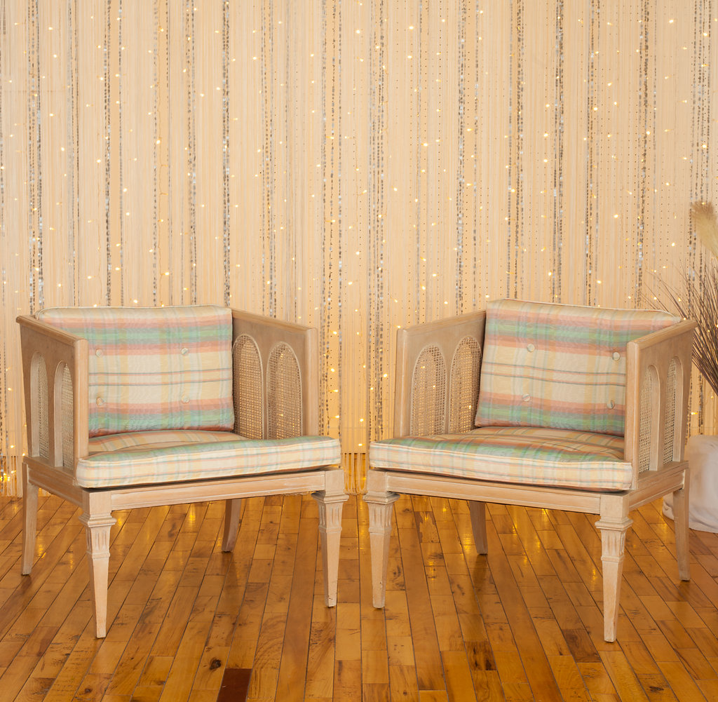 Mid-Century Modern Pastel-Colored pair of chairs anchor one of the homiest sets of the event.