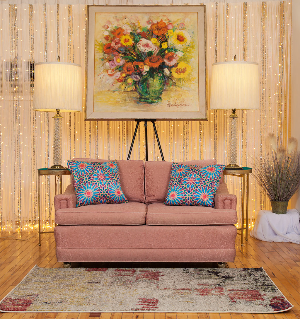 Featuring a Rose Love Seat and crystal lamps with fringe lampshades