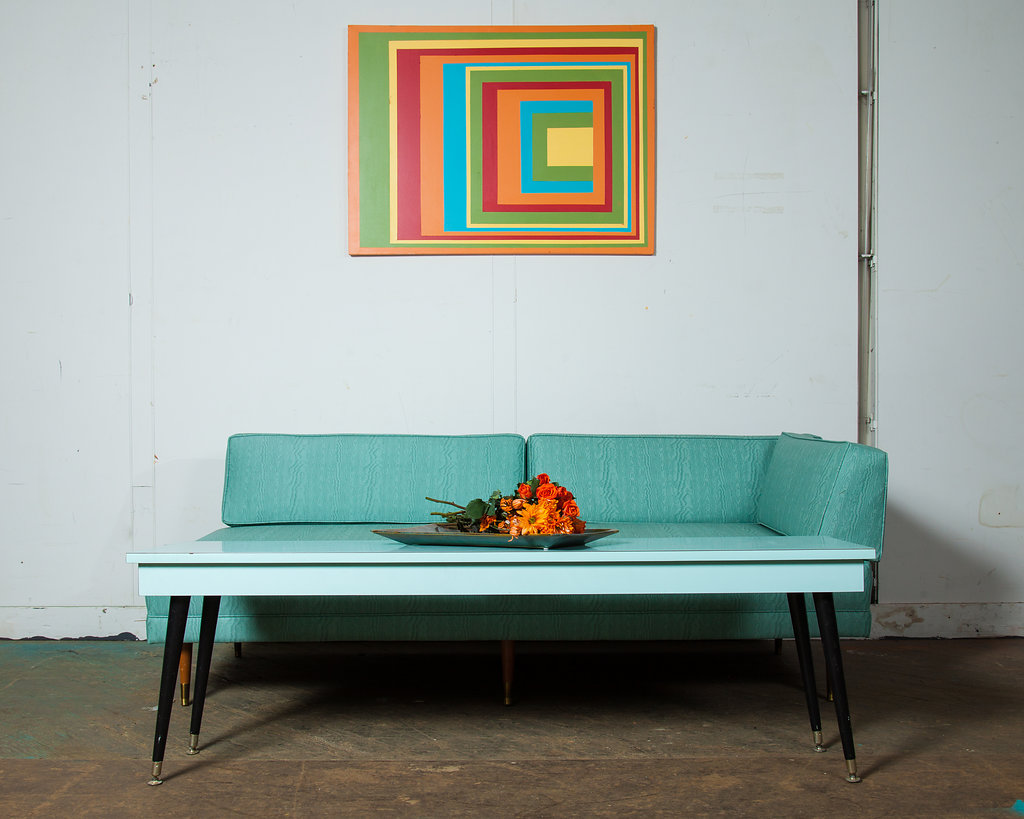 This 1960's  Aqua Daybed Sofa  is the perfect piece to lounge in on a lazy spring evening or to add colour pop to your home!