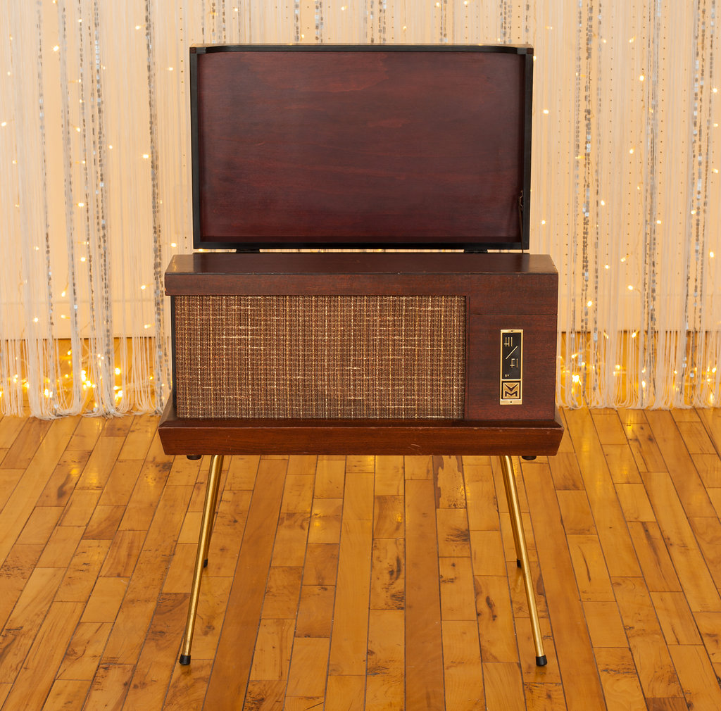 This Vintage Record Player (Non-Working) is a beautiful piece to bring some gold accents into any room in your house. With a little love, it could be working again. Or repurpose it by using it as a side table!