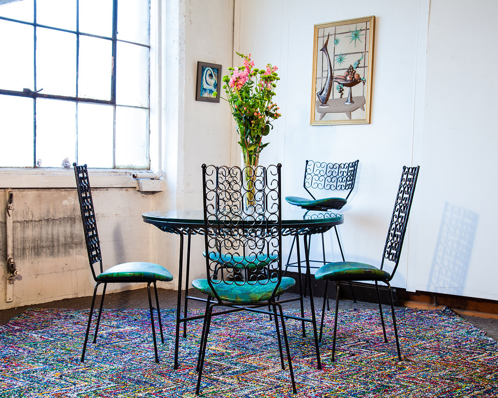 This 1960s Woodward Wrought Iron Design Patio Set will add an extra splash of beautiful and bright to the space.