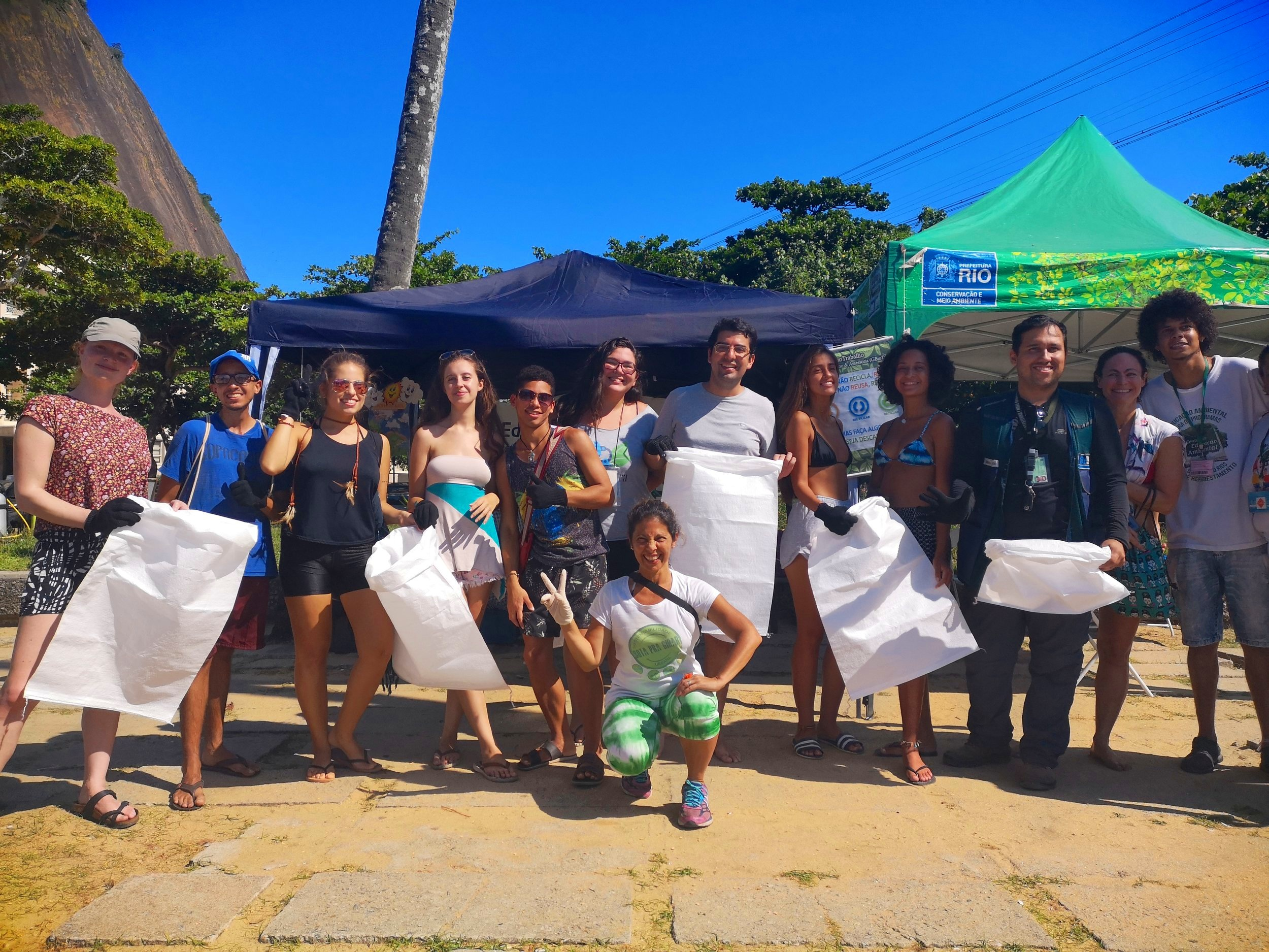 The beach-clean crew , including members of  Projeto Verde Mar  and Rio's Secretary of Environment Marcelo Queiroz.