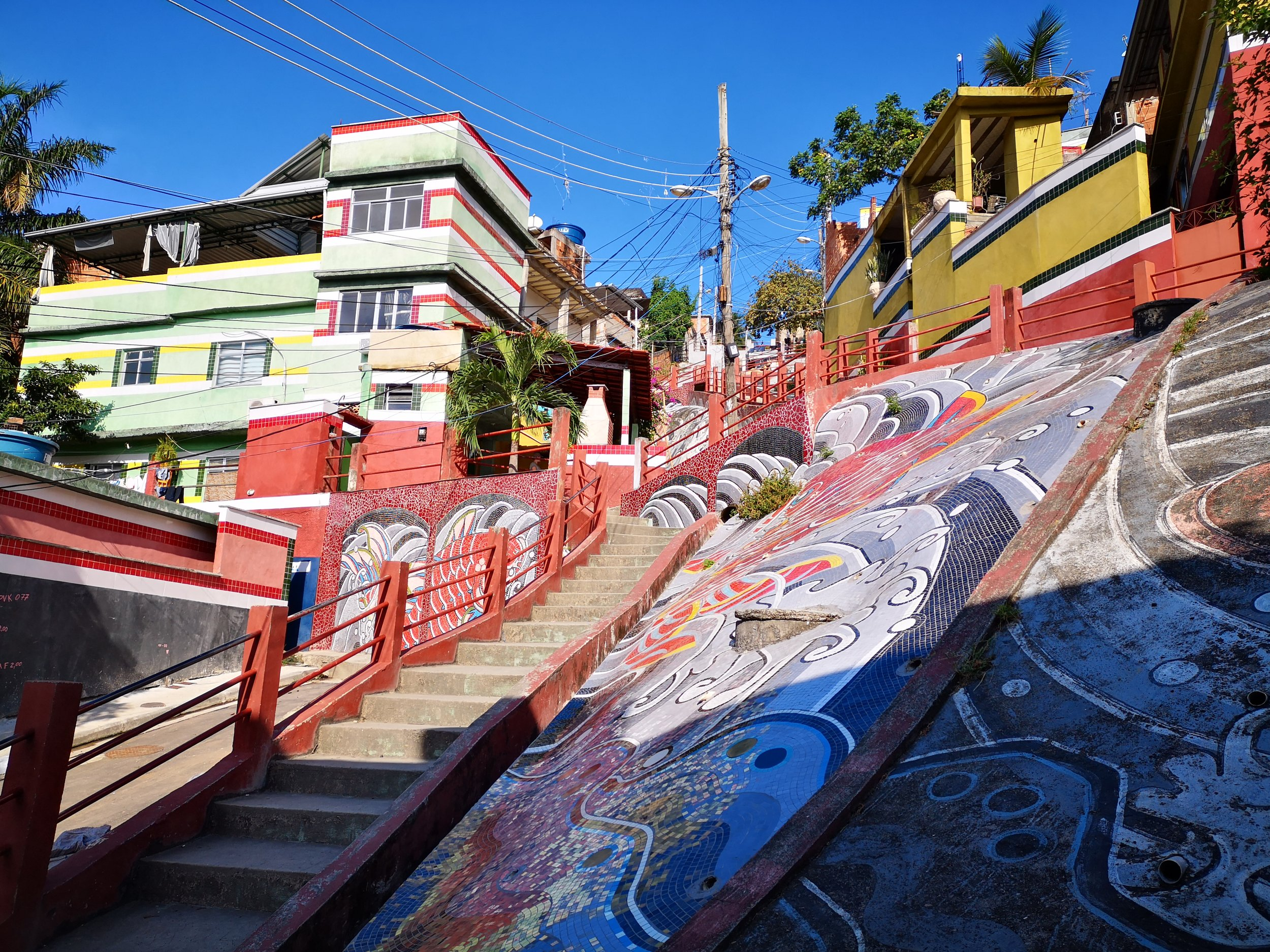 View from the bottom of the Rio Cruzeiro project, with the restored houses, 10-years-old paint and new mosaic all visible.