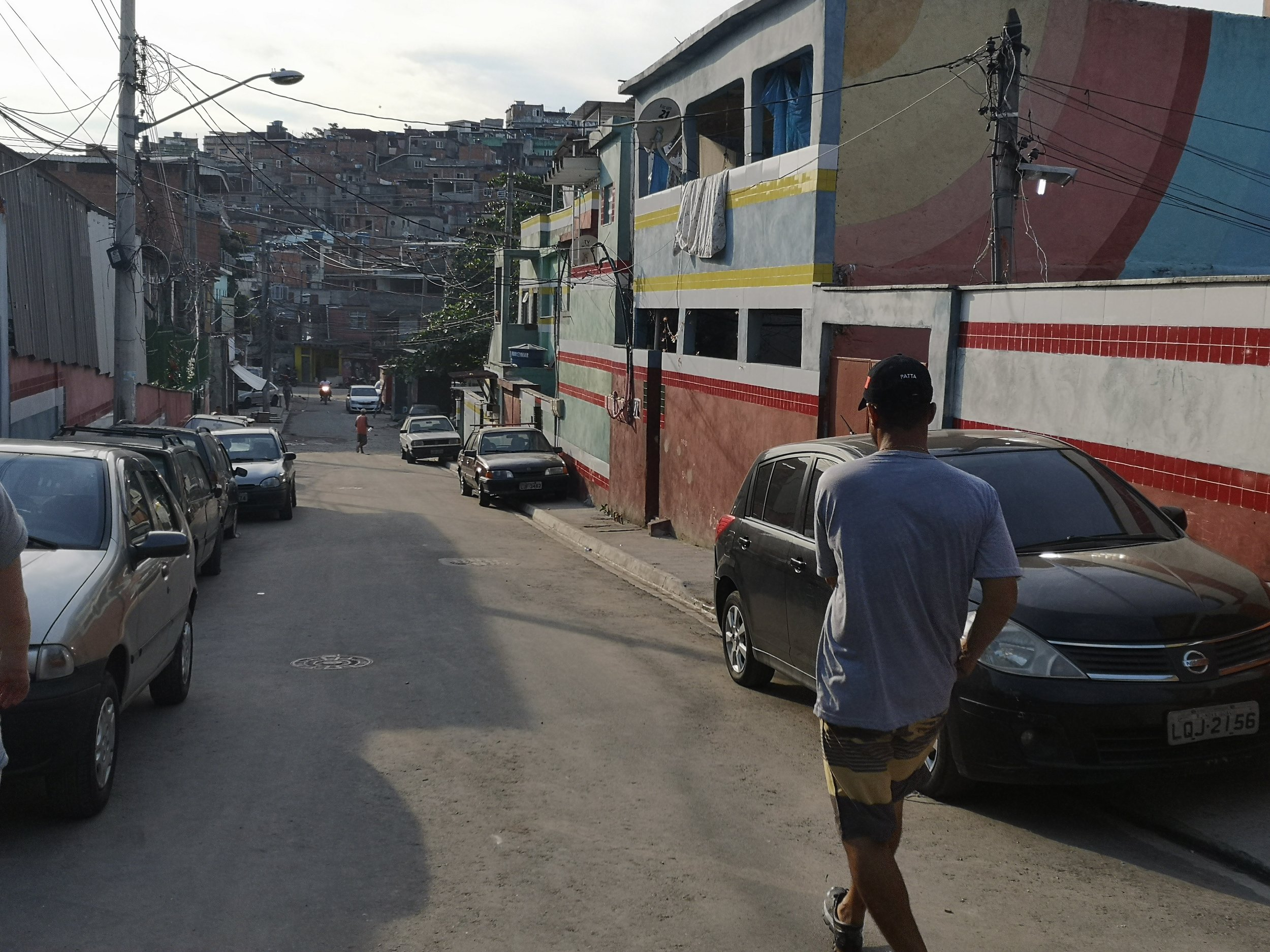 Walking back to the car with Fabio, after an amazing day in Vila Cruzeiro . The signature style of the Favella Painting also here visible on the houses.