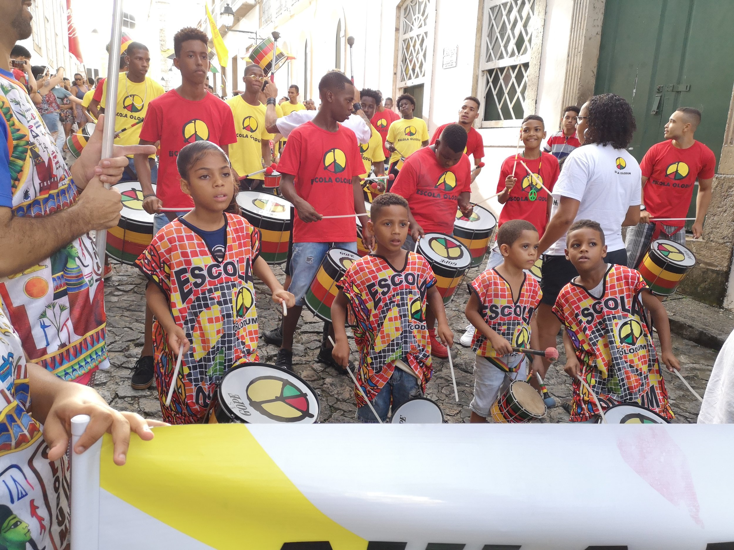 Marching through the small alleys of Pelourinho with some of the students of  Escola Olodum .