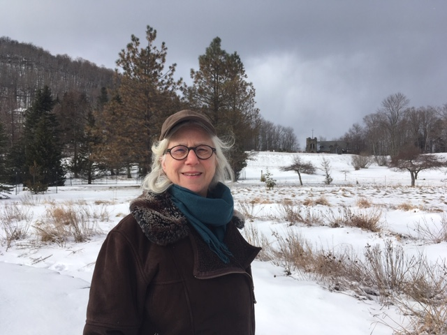 Susan before the wind-carved snow circling the West Meadow's spiral labyrinth on a chilly but inspiring March morning.