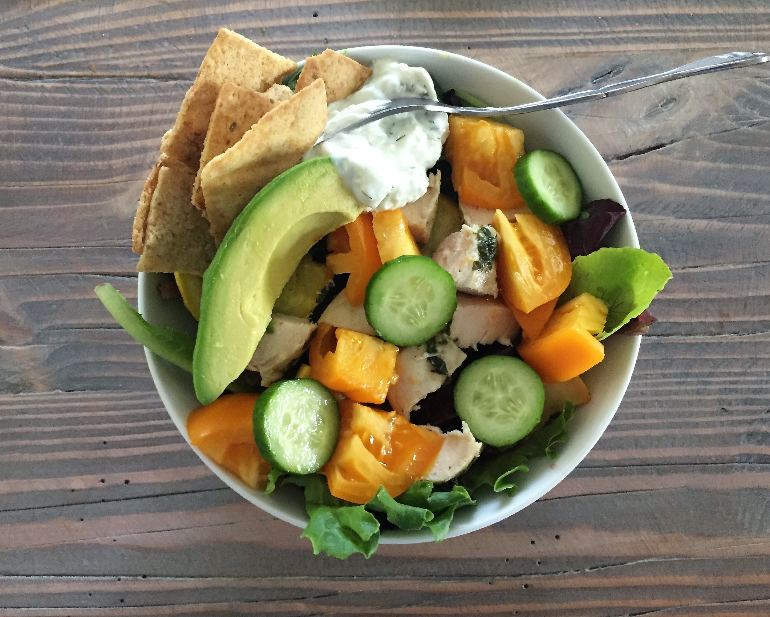 This salad started off with spring mix, tomatoes, cucumbers and squash. I had leftover basil chicken as a protein, and my fats were avocado and homemade tzatziki. I just used some vinegar as a dressing since I had two fats. (And some whole grain pita chips on the side!)
