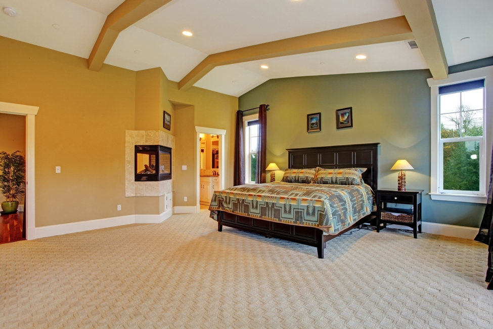 master bedroom in san diego home with carpeting