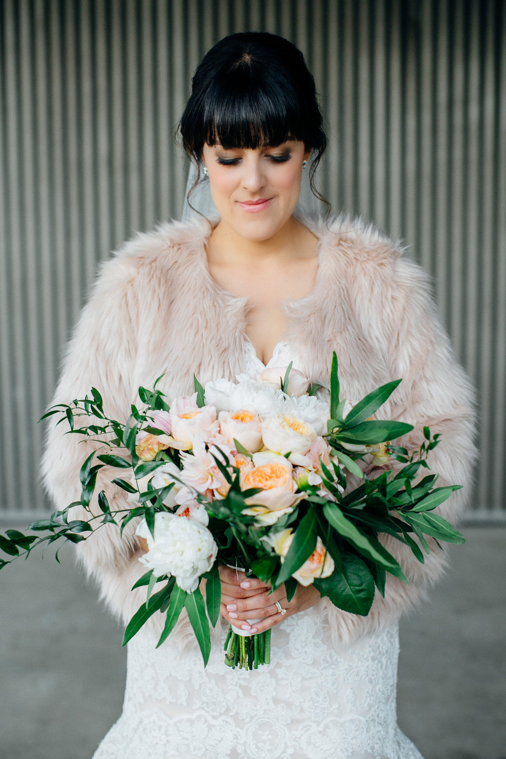 255e6-elegant-country-charm-ranch-wedding-stunning-bride-and-her-bridal-bouquet.jpg