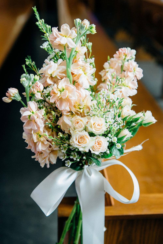 d39cd-elegant-country-charm-ranch-wedding-soft-pink-bouquets-line-pews.jpg