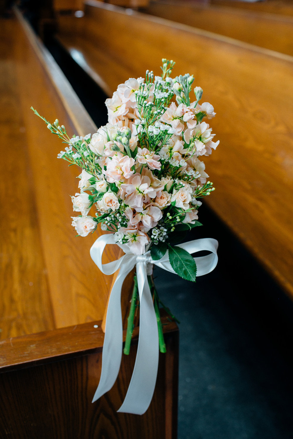 dd575-elegant-country-charm-ranch-wedding-soft-pink-floral-bouquets-line-the-pews.jpg