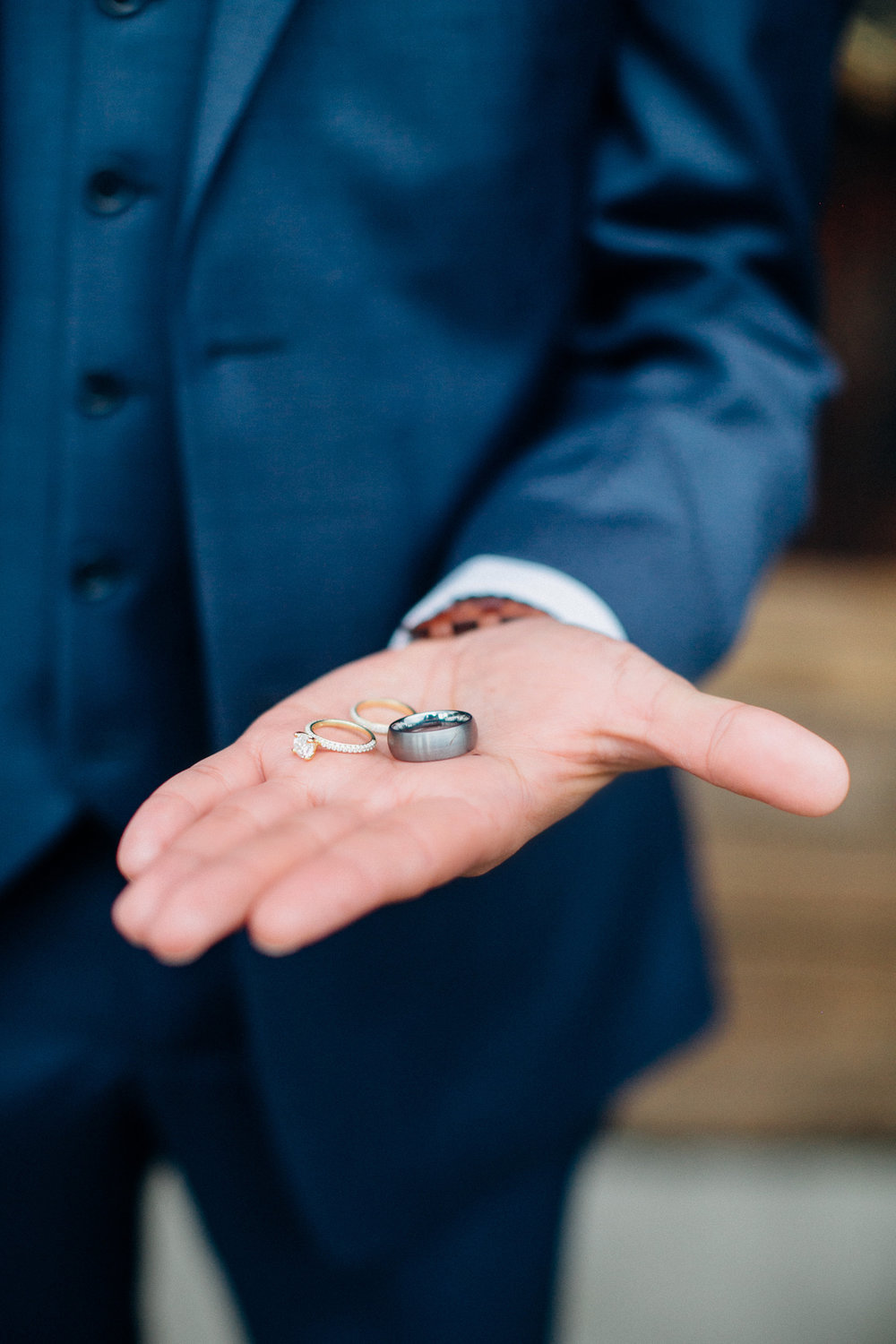 ed724-elegant-country-charm-ranch-wedding-groom-proudly-showing-off-their-rings.jpg
