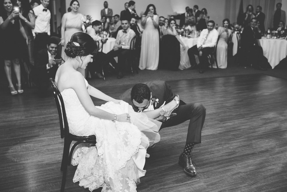 f3c7c-elegant-country-charm-ranch-wedding-bride-removing-the-garter.jpg