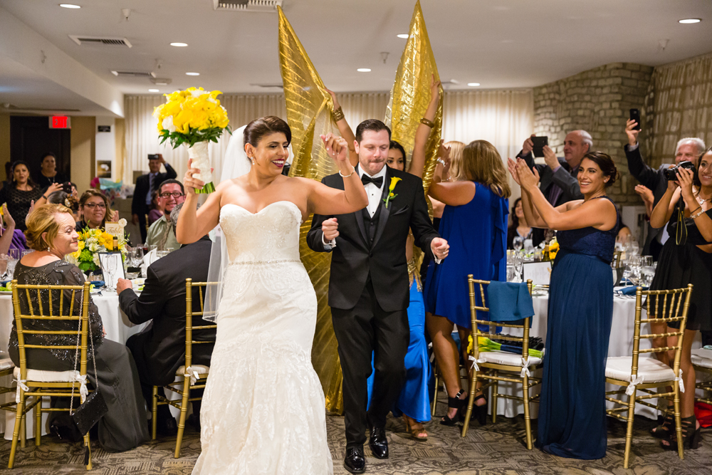 18b56-lively-navy-yellow-harbor-wedding-bride-and-groom-entering-with-entertainment.jpg