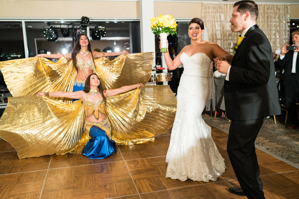 2d3c4-lively-navy-yellow-harbor-wedding-belly-dancers-dancing-with-bride-and-groom.jpg