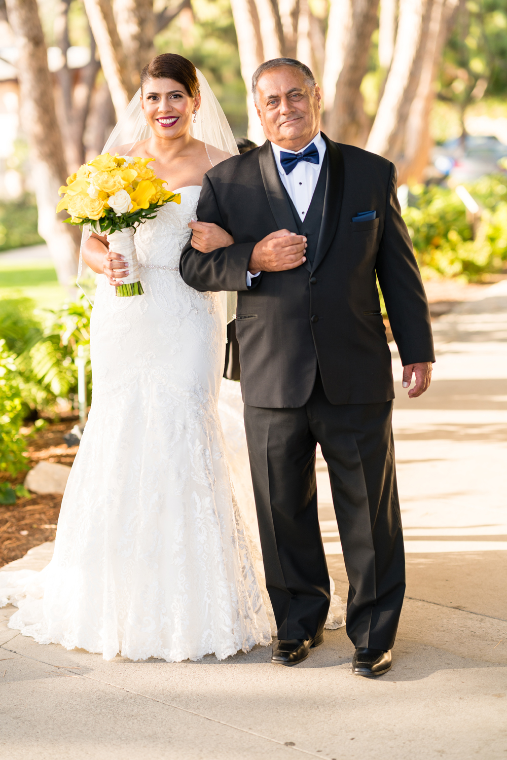 34363-lively-navy-yellow-harbor-wedding-proud-father-walking-bride-down-aisle.jpg