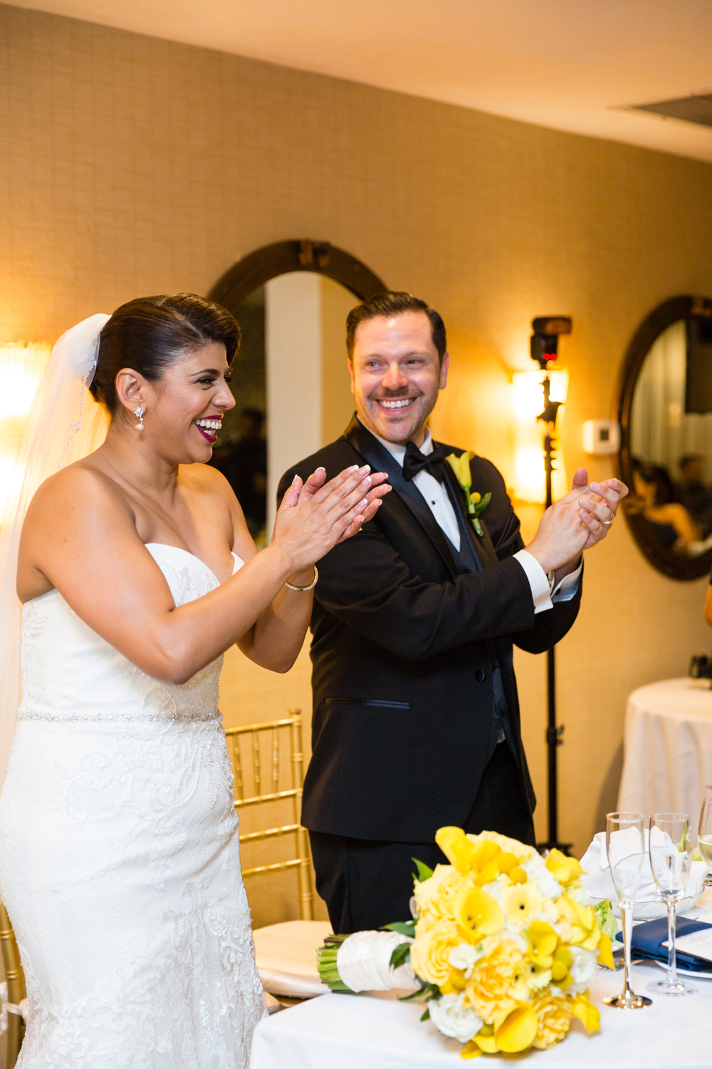 54706-lively-navy-yellow-harbor-wedding-bride-and-groom-enjoying-entertainment.jpg