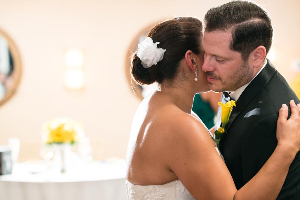 631da-lively-navy-yellow-harbor-wedding-sweet-monent-between-bride-groom.jpg