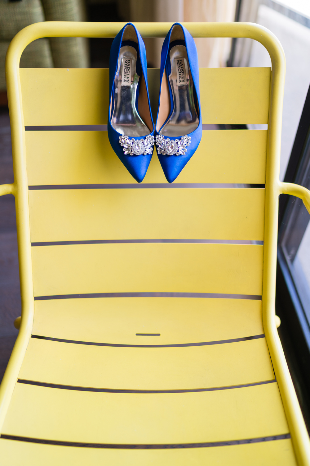 b2b33-lively-navy-yellow-harbor-wedding-bright-blue-shoes-sunny-yellow-chair.jpg
