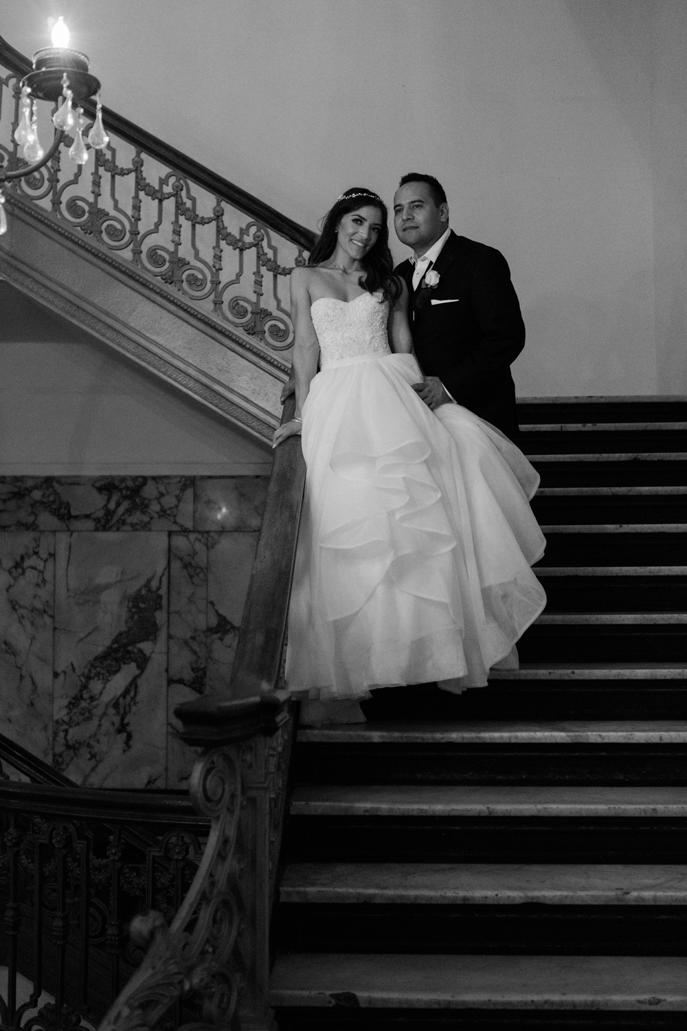 e3610-pretty-in-pink-vintage-hollywood-fiesta-wedding-alexandria-ballroom-bride-and-groom-ornate-staircase.jpg