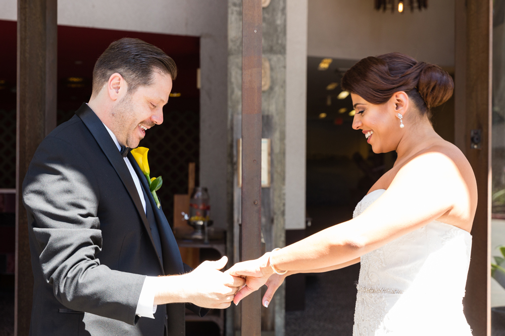 ea2d1-lively-navy-yellow-harbor-wedding-groom-loves-brides-dress.jpg