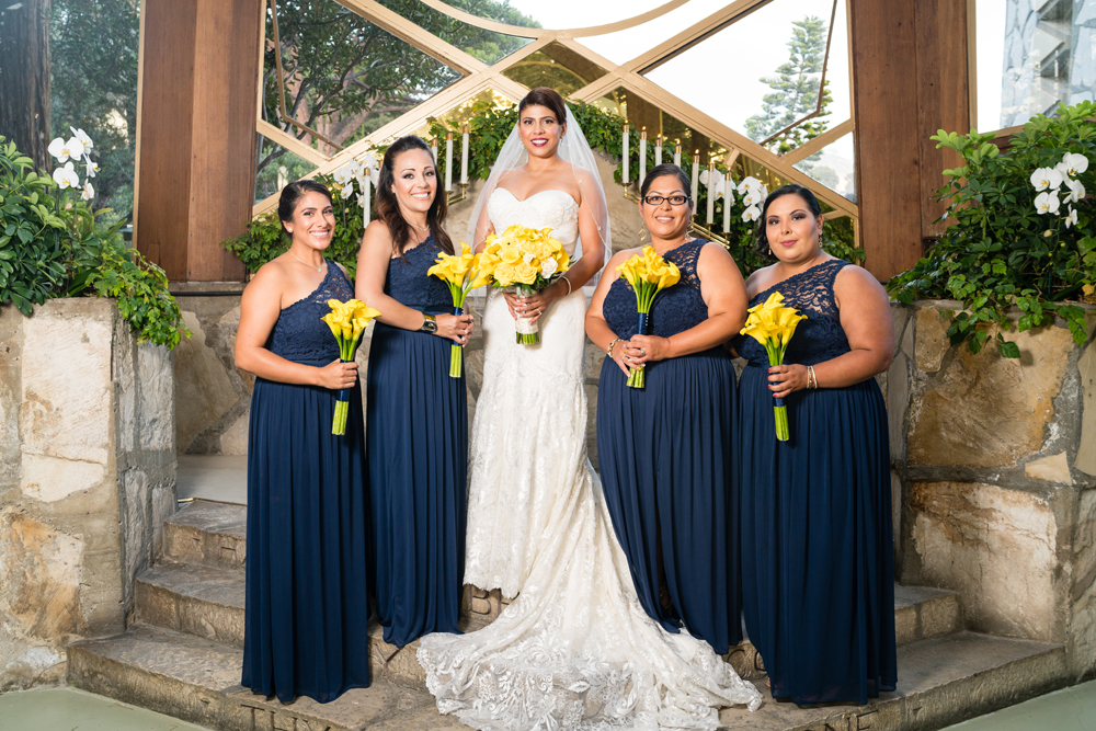 ef4ed-lively-navy-yellow-harbor-wedding-bride-and-her-bridesmaids.jpg