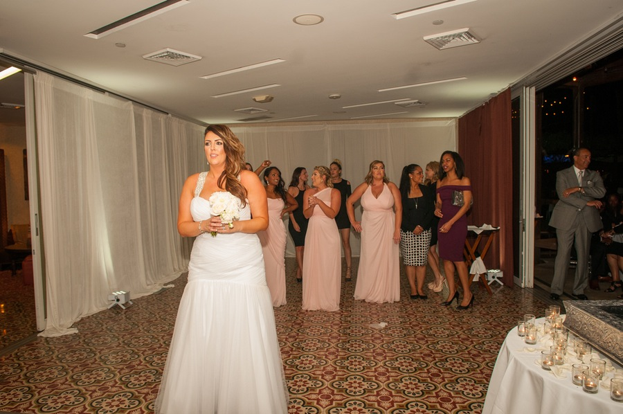 21447-beautiful-joyful-harborside-wedding-getting-ready-to-toss-bouquet.jpg