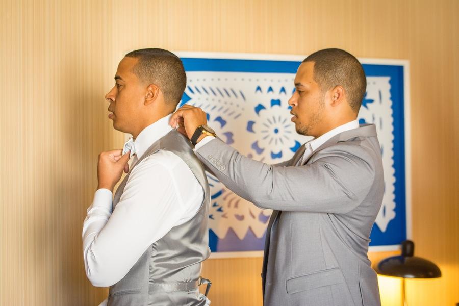 3c81d-beautiful-joyful-harborside-wedding-groomsman-helping-out-the-groom.jpg