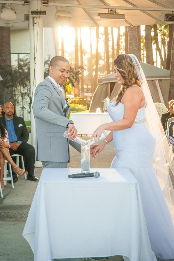 844a6-beautiful-joyful-harborside-wedding-sand-unity-ceremony.jpg
