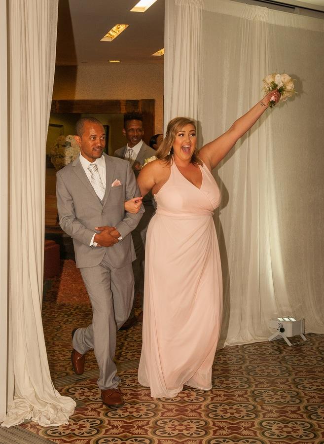 cdd01-beautiful-joyful-harborside-wedding-excited-wedding-party-in-the-house.jpg