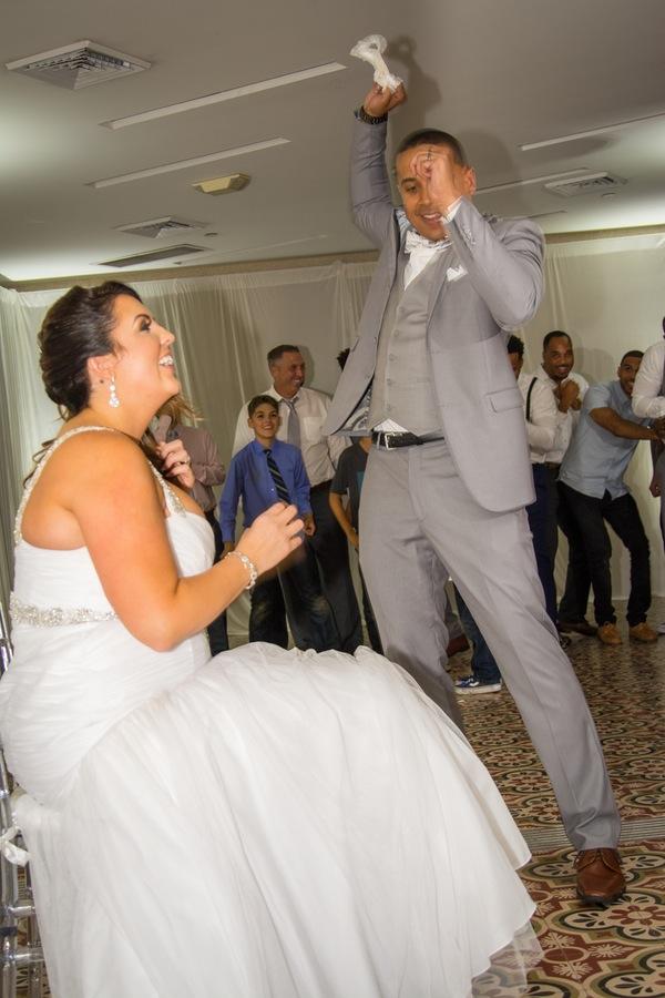 f995d-beautiful-joyful-harborside-wedding-groom-throwing-garter.jpg