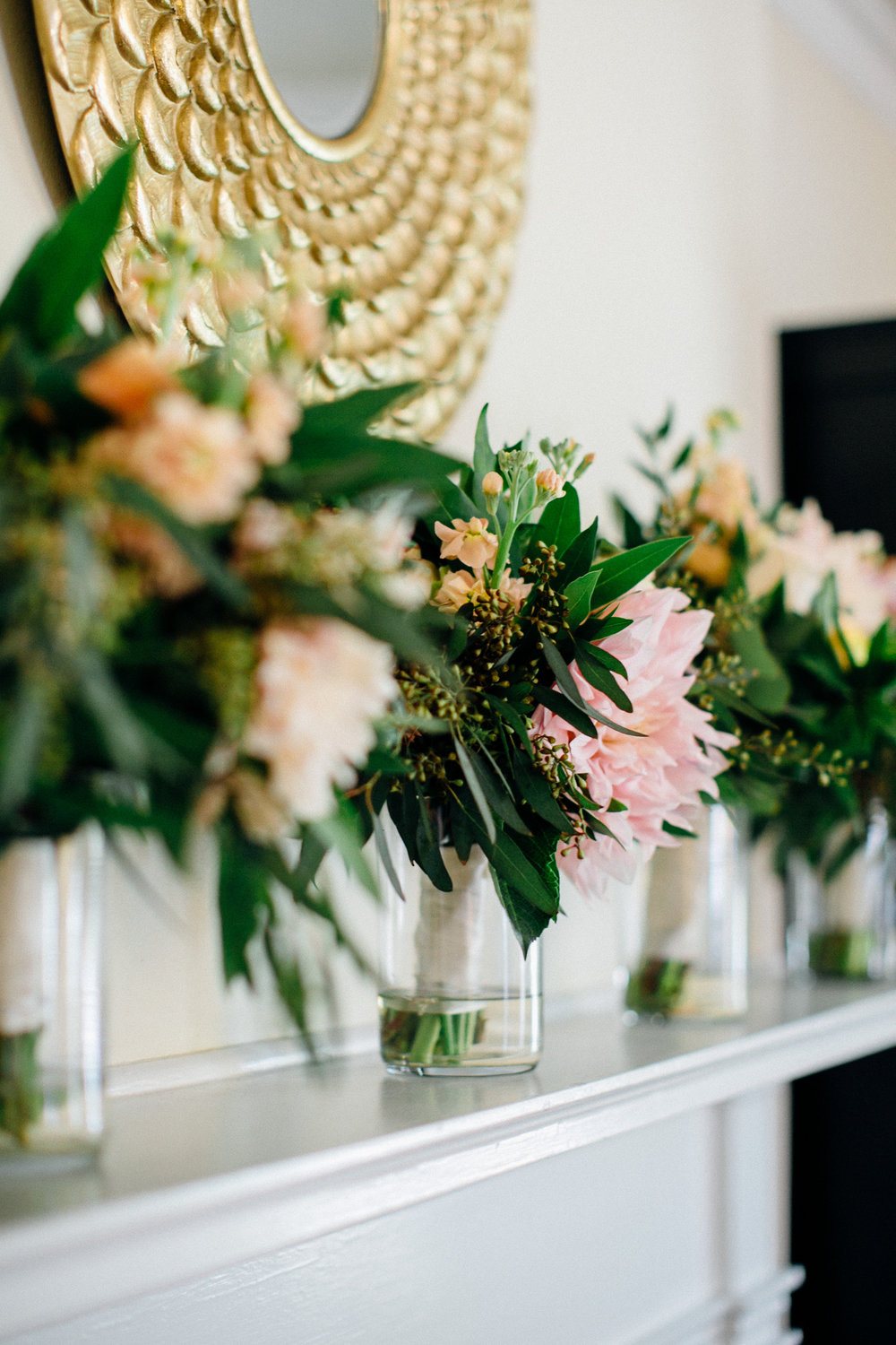 ccb9a-elegant-country-charm-ranch-wedding-bridal-bouquets-displayed-on-mantle.jpg