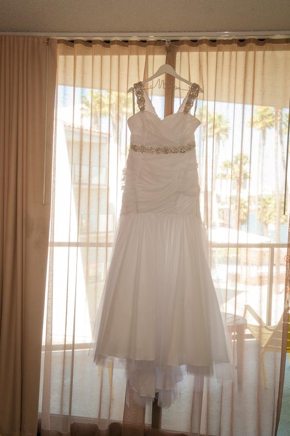 c59cf-beautiful-joyful-harborside-wedding-bridal-gown-hanging-in-bridal-suite.jpg