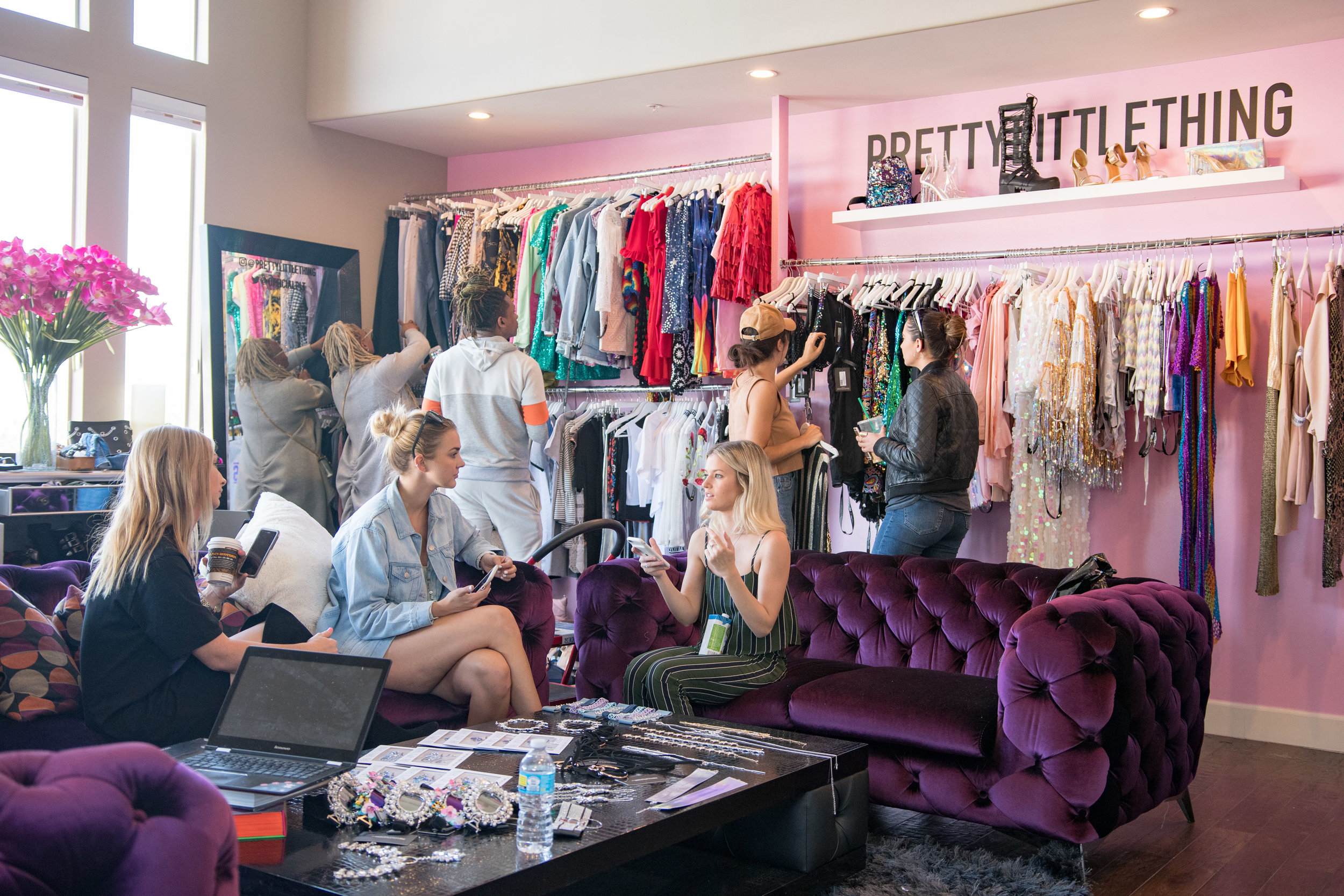 Peek Inside Celebrity Pre-Coachella Gifting Suite hanging on the purple couches PLT party.jpg