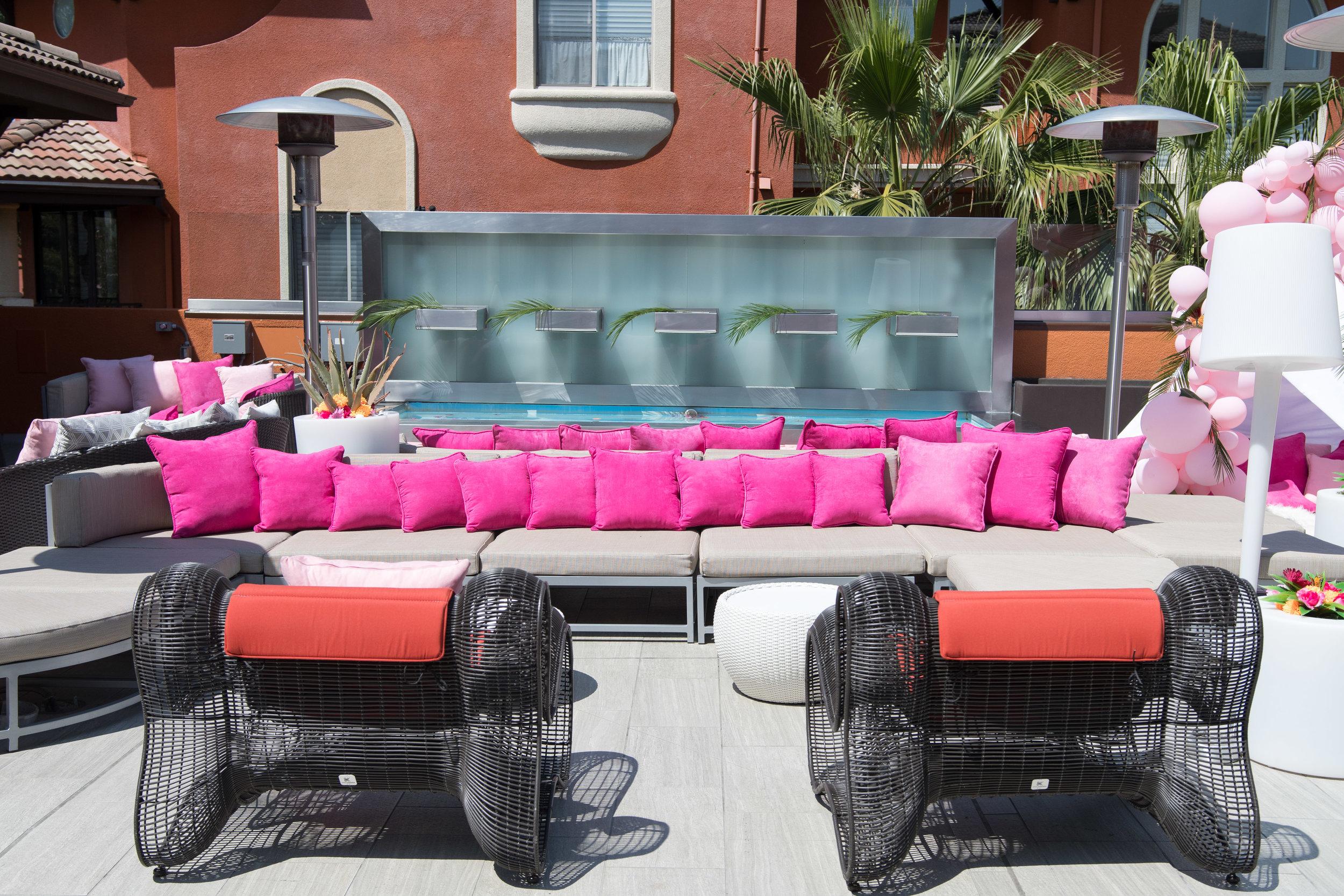 Peek Inside Celebrity Pre-Coachella Gifting Suite PLT poolside in pink.jpg