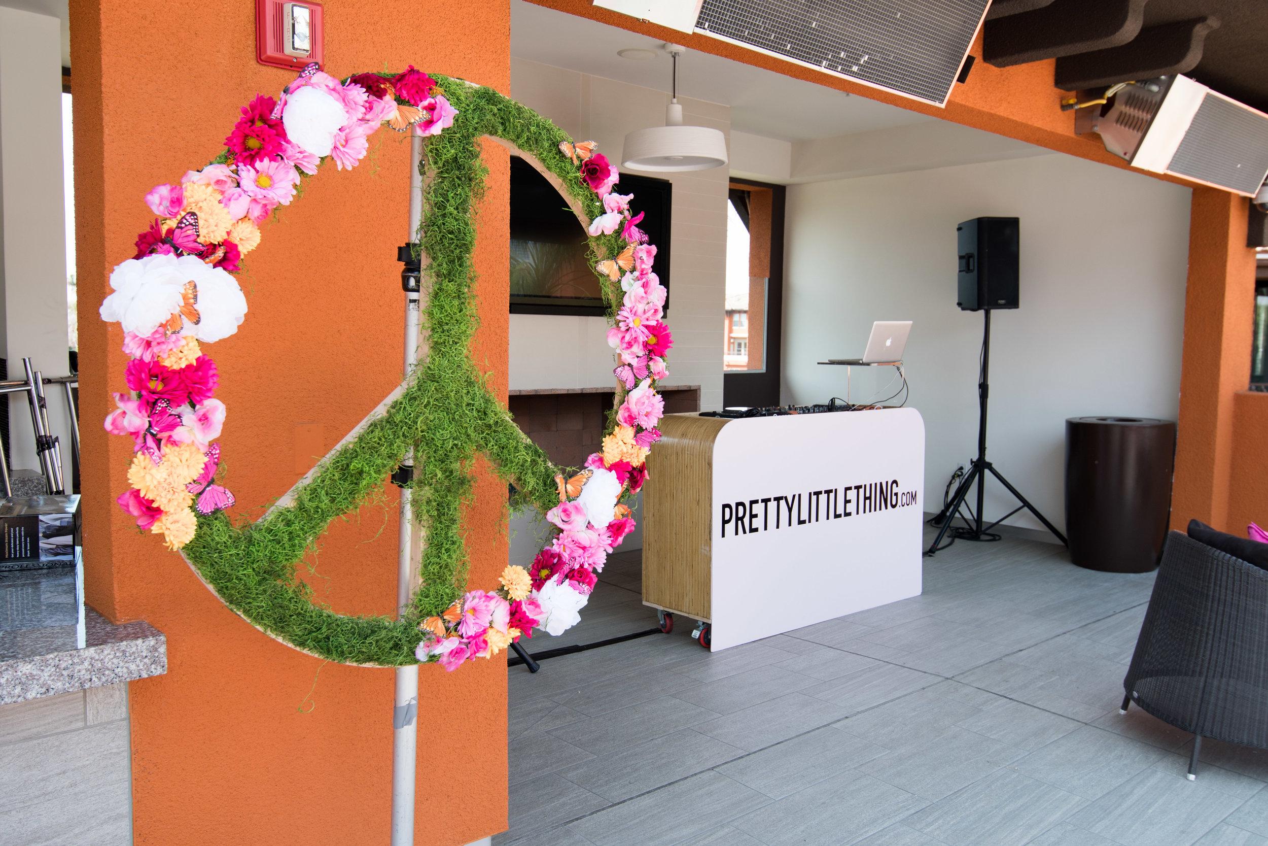 Peek Inside Celebrity Pre-Coachella Gifting Suite PLT party floral peace sign.jpg