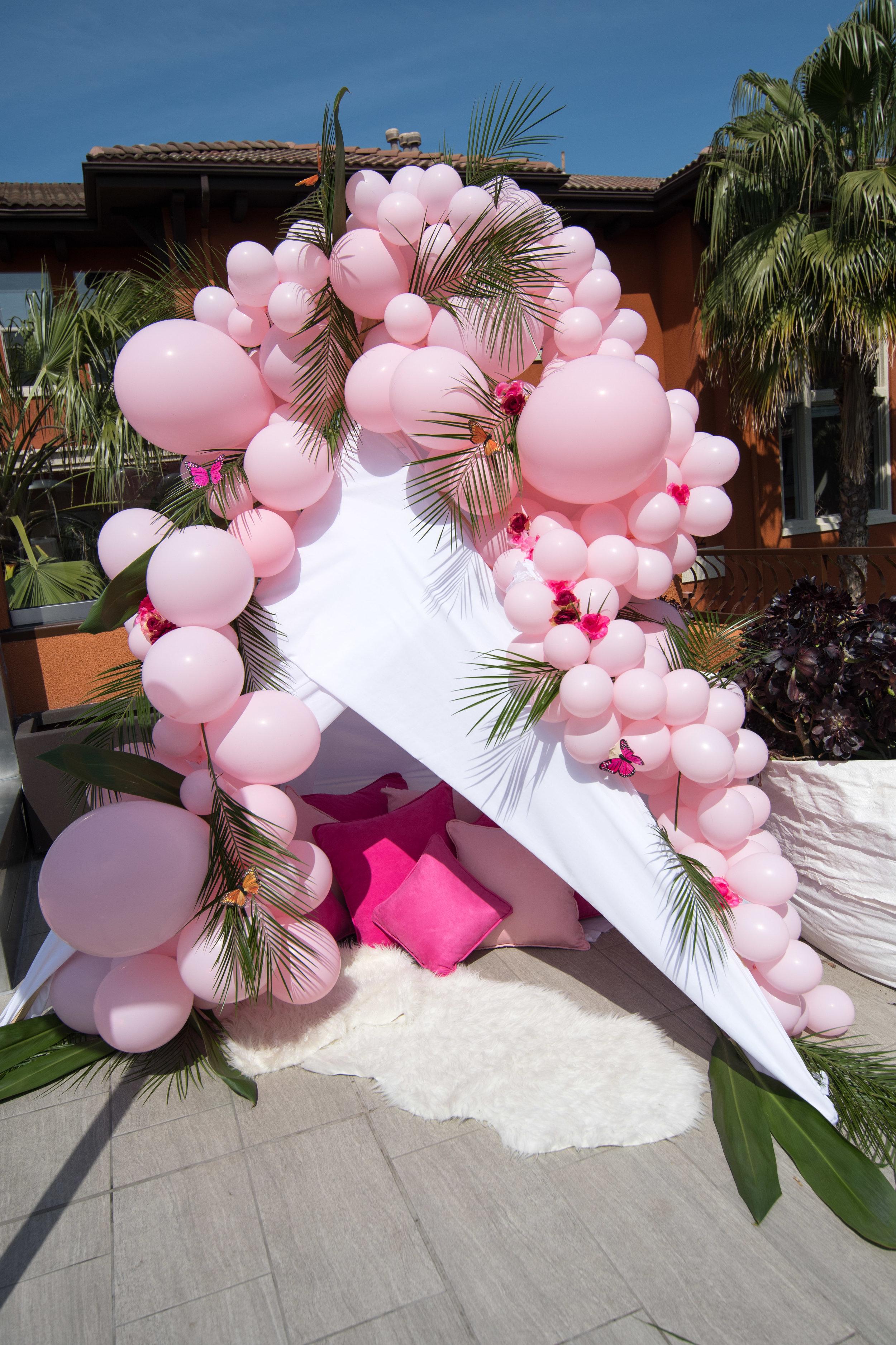 Peek Inside Celebrity Pre-Coachella Gifting Suite pink boho tent pink balloons.jpg