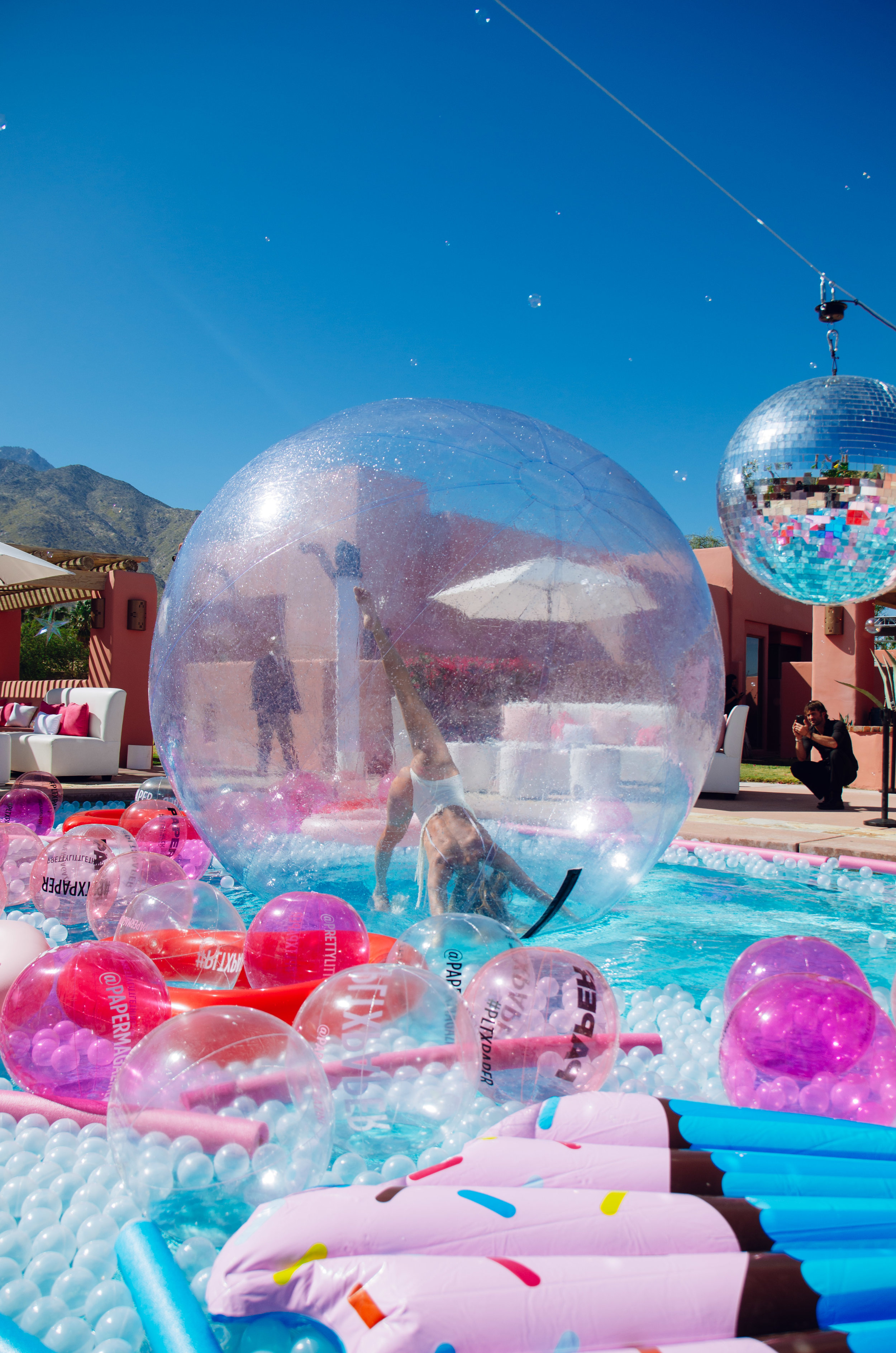 Ultimate Hollywood Coachella Poolside Party entertainer in pool bubble.jpg