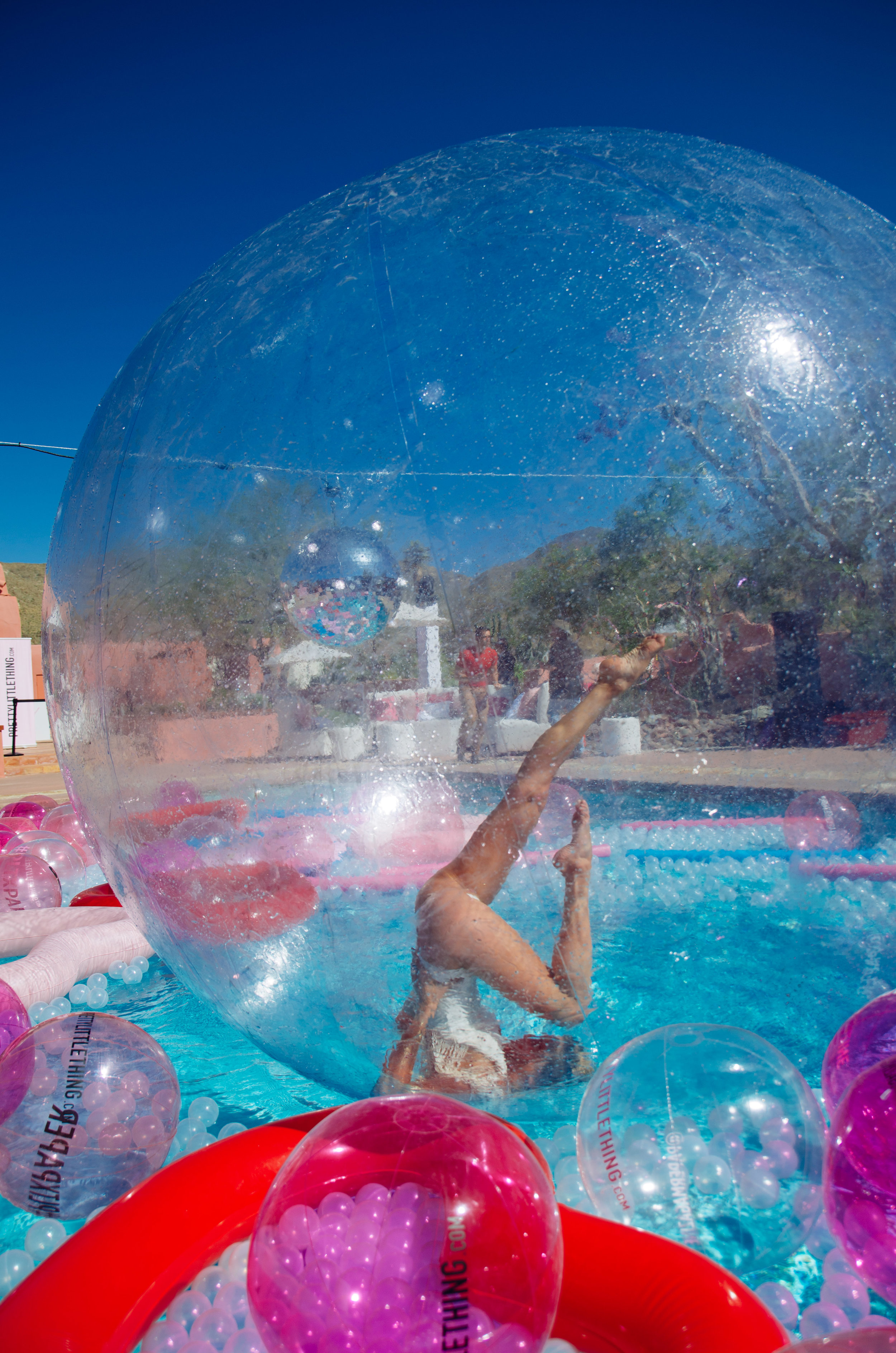 Ultimate Hollywood Coachella Poolside Party entertainer in the bubble.jpg