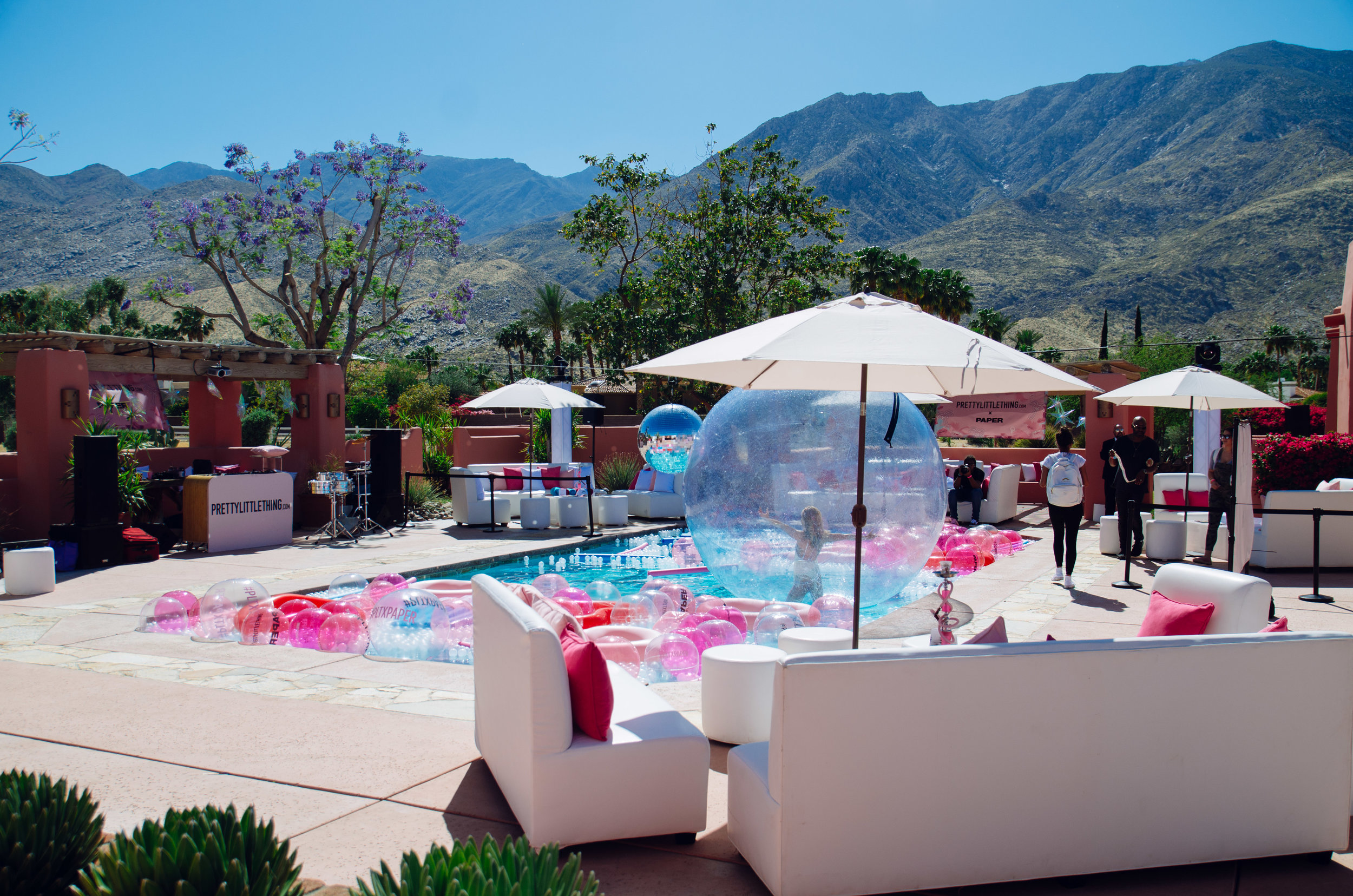 Ultimate Hollywood Coachella Poolside Party pink beach balls fill the pool.jpg