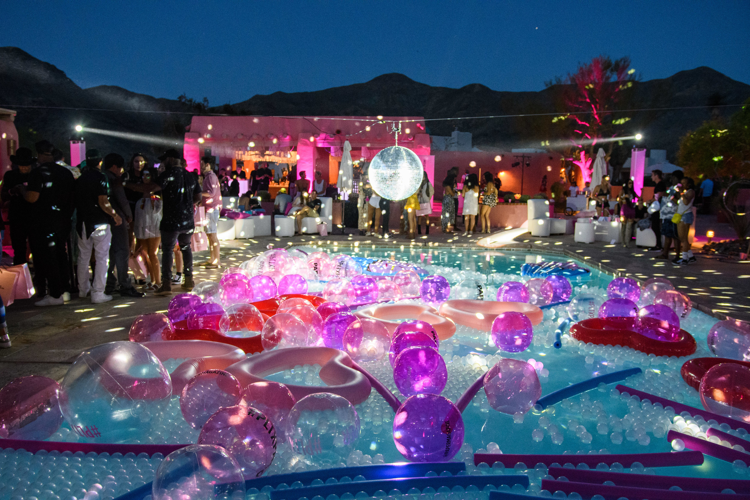 Ultimate Hollywood Coachella Poolside Party disco ball spins above the pool.jpg